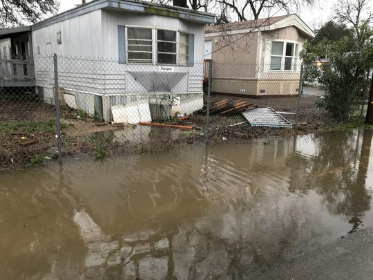 About 60 homes off Jewell Lane just west of Highway 273 were evacuated as the water from nearby Olney Creek rose to about 3 feet deep in the neighborhood Tuesday night, Feb. 26, 2019.