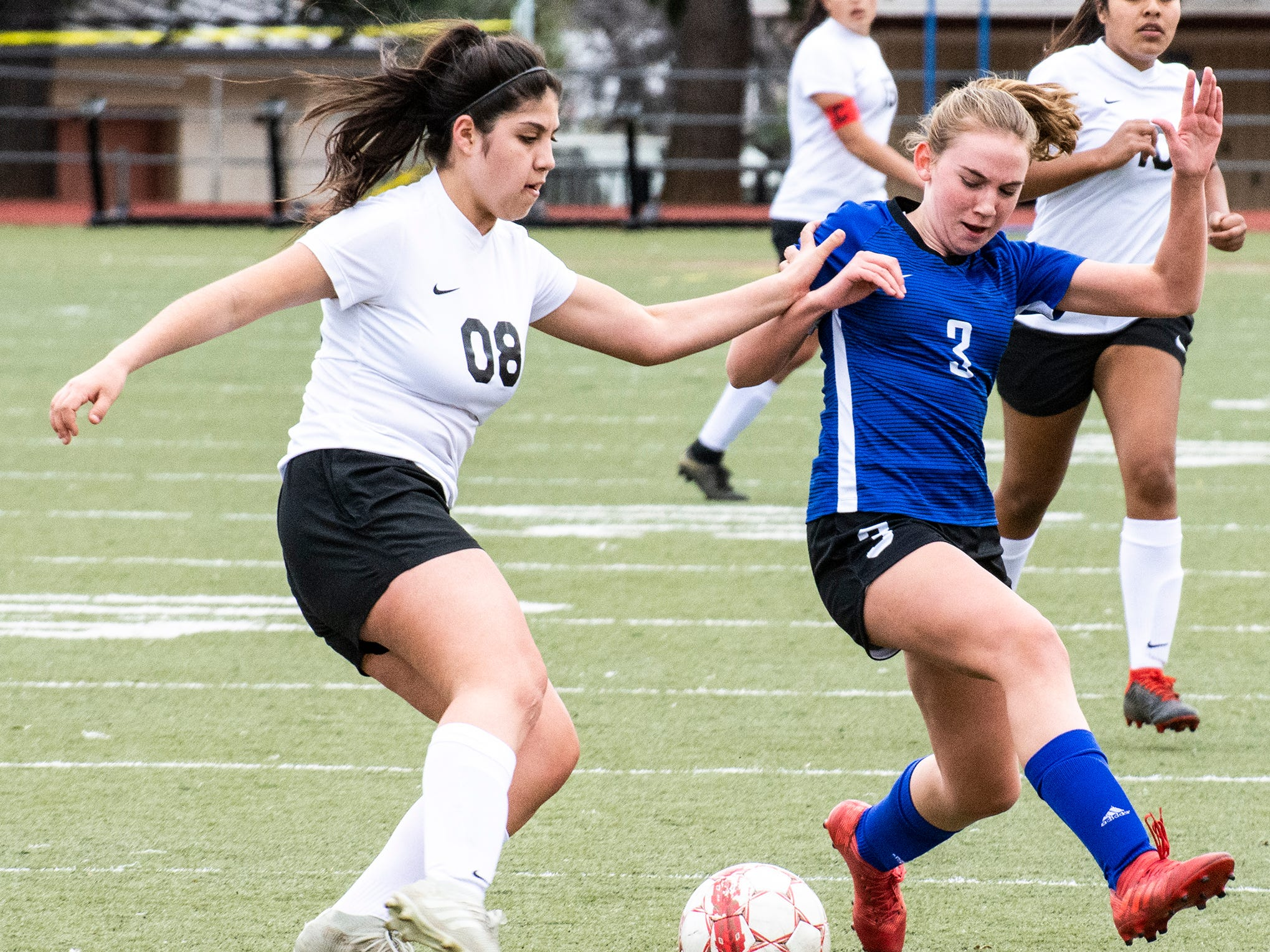 U-Prep junior Sami Isheim (right) and Corning's Gissel Rico fight for possession of the ball during the Panthers' 4-1 win in the Division II Northern Section championship on Saturday, Feb. 23.