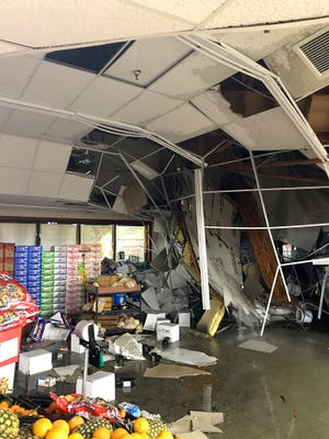 Part of the roof of the Sav-Mor grocery store off Westside Road collapsed late Tuesday night, Feb. 26, 2019, during a storm.