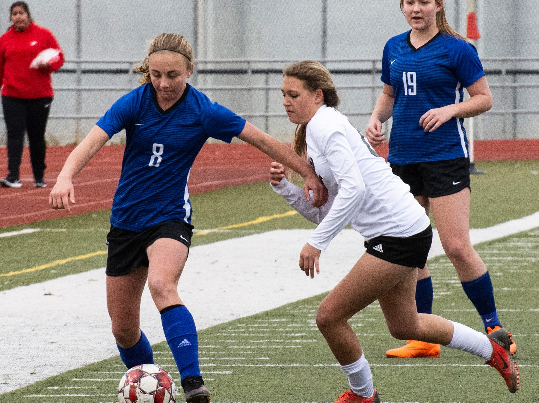 U-Prep midfielder Rebecca Gaido shields the ball from Corning's Brianna Cardoso during the Panthers' 4-1 win in the Division II Northern Section championship on Saturday, Feb. 23.