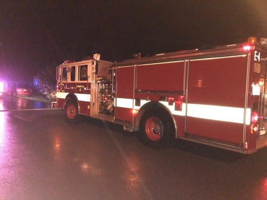 A Redding Fire Department engine helps residents evacuate a neighborhood near flood-swollen Olney Creek in south Redding Tuesday night, Feb. 26, 2019.
