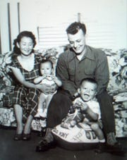 Young Richard Maxion, front right, with his sibling and parents Chong Woon and David Maxion.