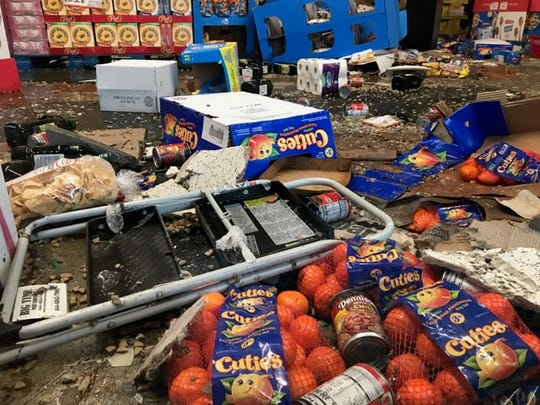 Groceries are strewn across the floor at Sav-Mor Foods in south Redding after a portion of the roof collapsed due to the heavy rains.