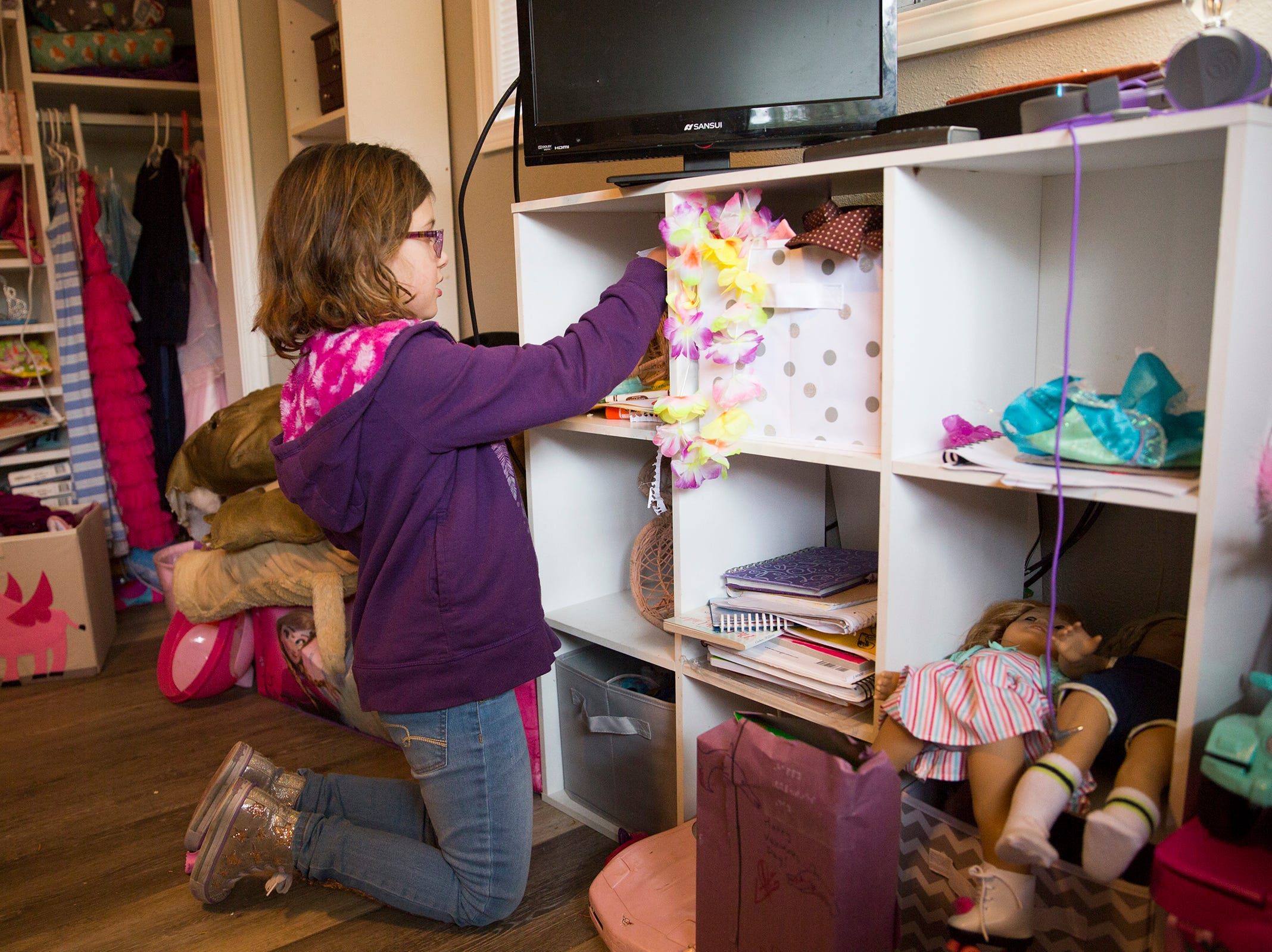 Haley Pollman, 9, pulls out her favorite toys and belongings from around her room at her home in Salem on Saturday, Feb. 23, 2019.