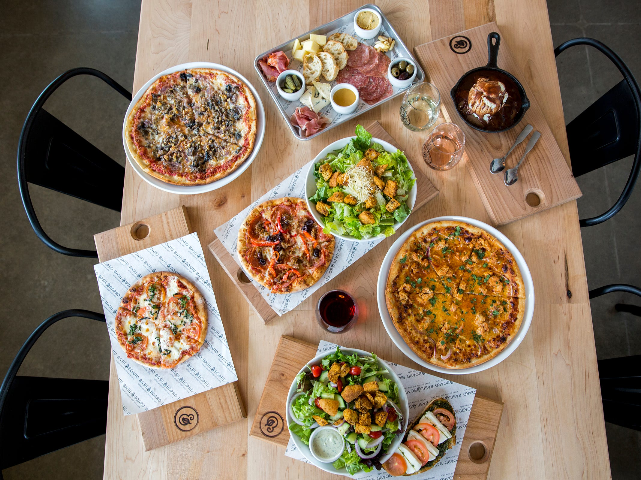 Pizzas, snacks, salads and dessert from the new lunch menu at Basil & Board in Salem on Tuesday, Feb. 26, 2019.