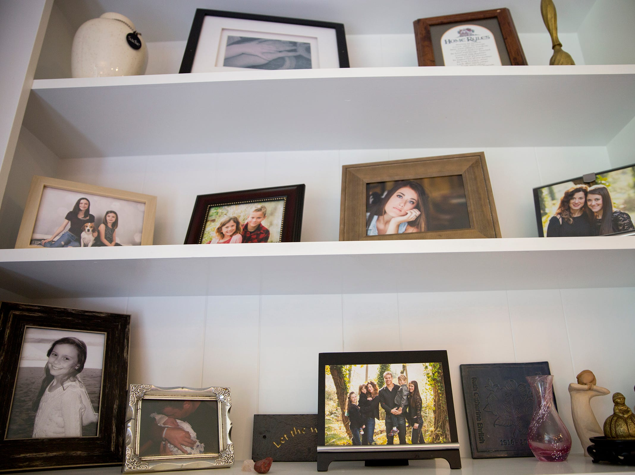 Picture frames fill the shelfs at the Pollman home in Salem on Saturday, Feb. 23, 2019.