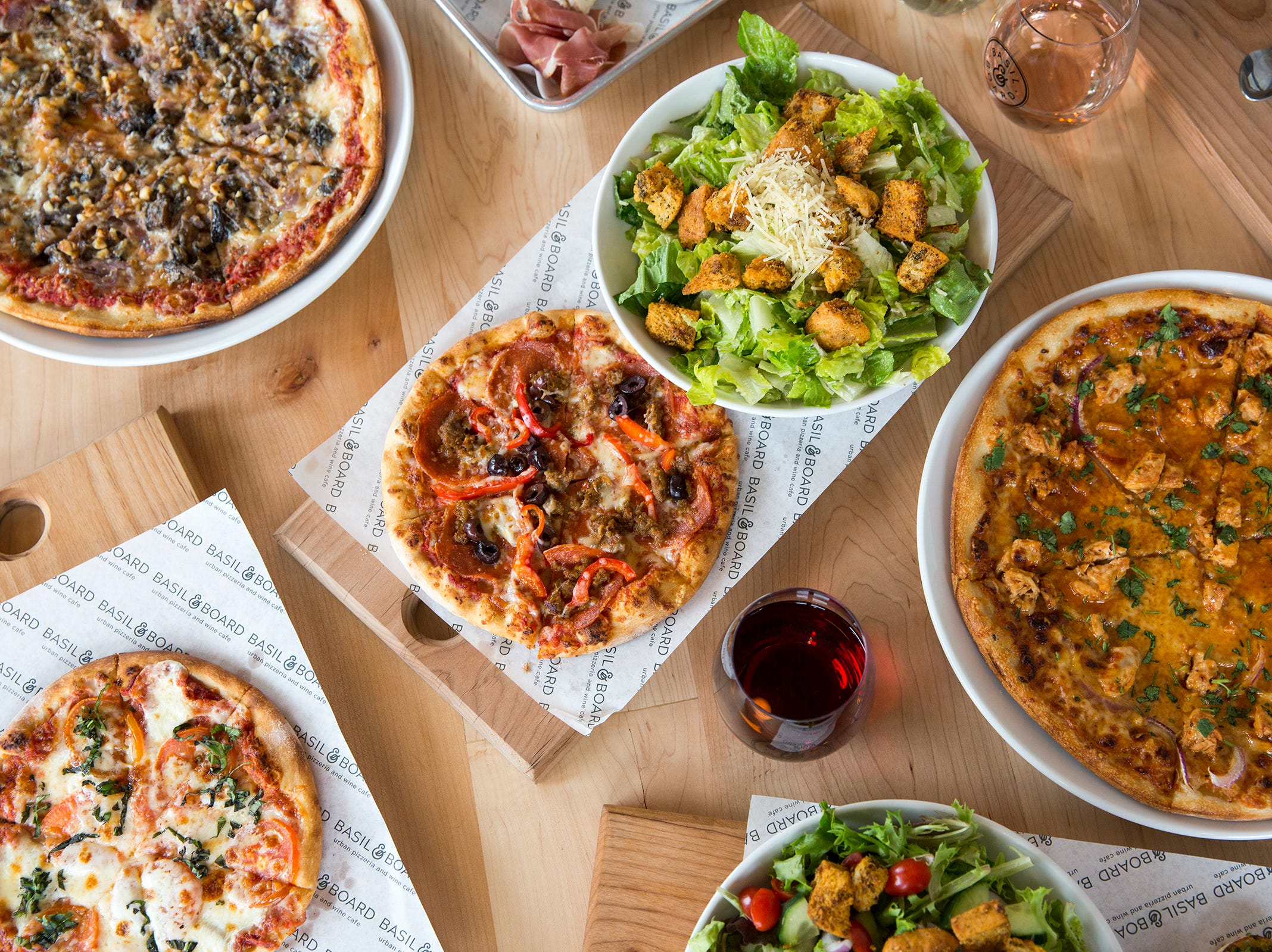 Pizzas, snacks, salads and dessert from the new lunch menu at Basil & Board in Salem Tuesday, Feb. 26, 2019.