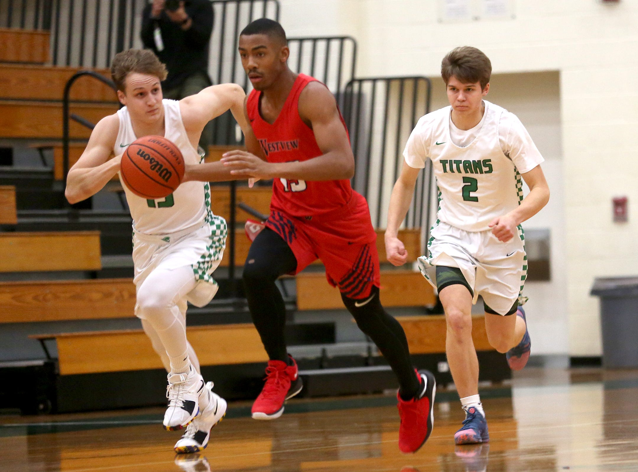 Westview's Wayne Jamison (15) protects the ball from West Salem defenders during the West Salem vs. Westview 6A Boys Basketball State Championships first round at West Salem High School in Salem on Tuesday, Feb. 26, 2019.