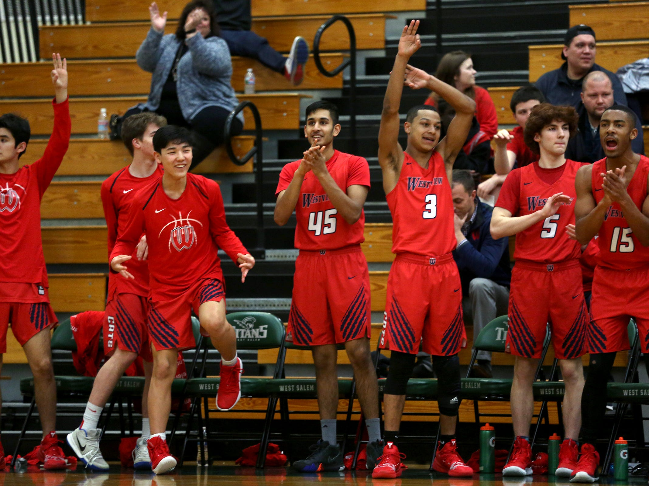 Westview's bench celebrates during the West Salem vs. Westview 6A Boys Basketball State Championships first round at West Salem High School in Salem on Tuesday, Feb. 26, 2019.