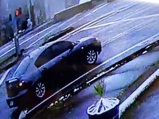 The car of interest in the Jefferson bank robbery is described as a gray Mazda four-door with a spoiler on the back, investigators said.