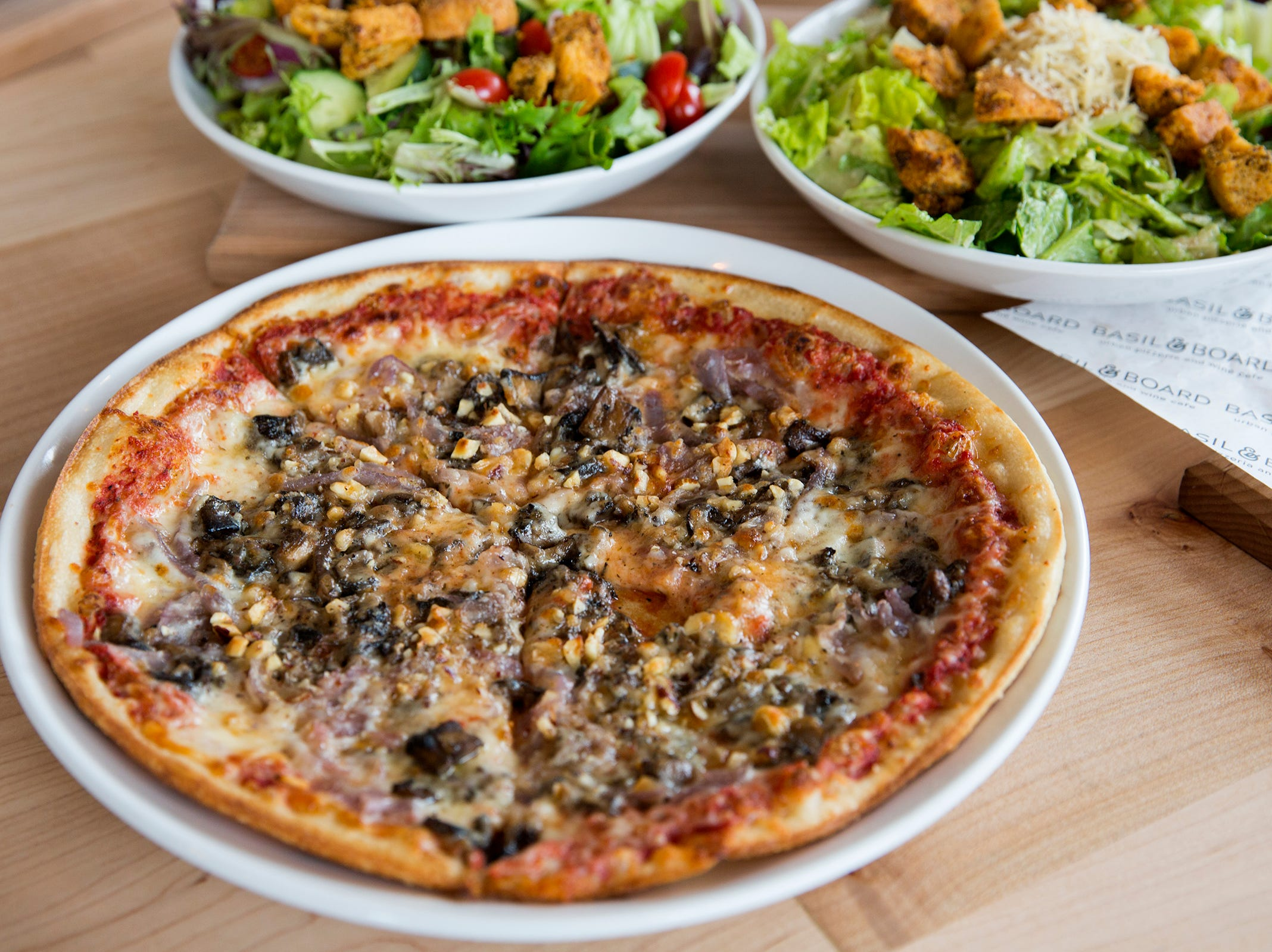 The Pacific Crest Trail 10-inch pizza, with forest mushrooms, toasted hazelnuts, caramelized onion and honey, is pictured at Basil & Board in Salem on Tuesday, Feb. 26, 2019.