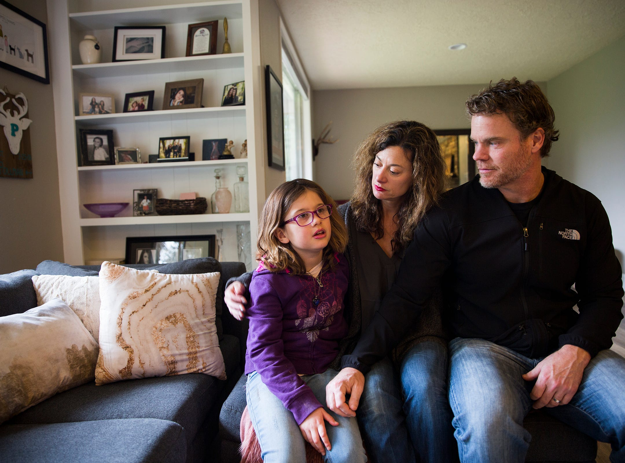 Haley Pollman, 9, and her parents Melissa Pollman and Dean Pollman at their home in Salem on Saturday, Feb. 23, 2019. Haley has Batten disease, a rare disorder of the nervous system.
