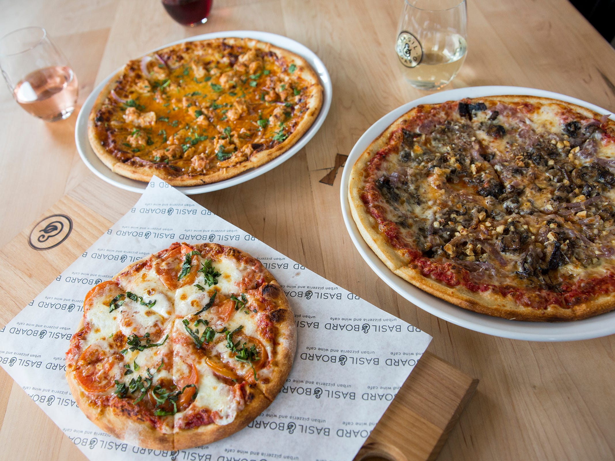 The Pacific Crest Trail pizza, the BBQ Bird pizza and a lunch sized Margherita pizza are laid out at Basil & Board in Salem on Tuesday, Feb. 26, 2019.