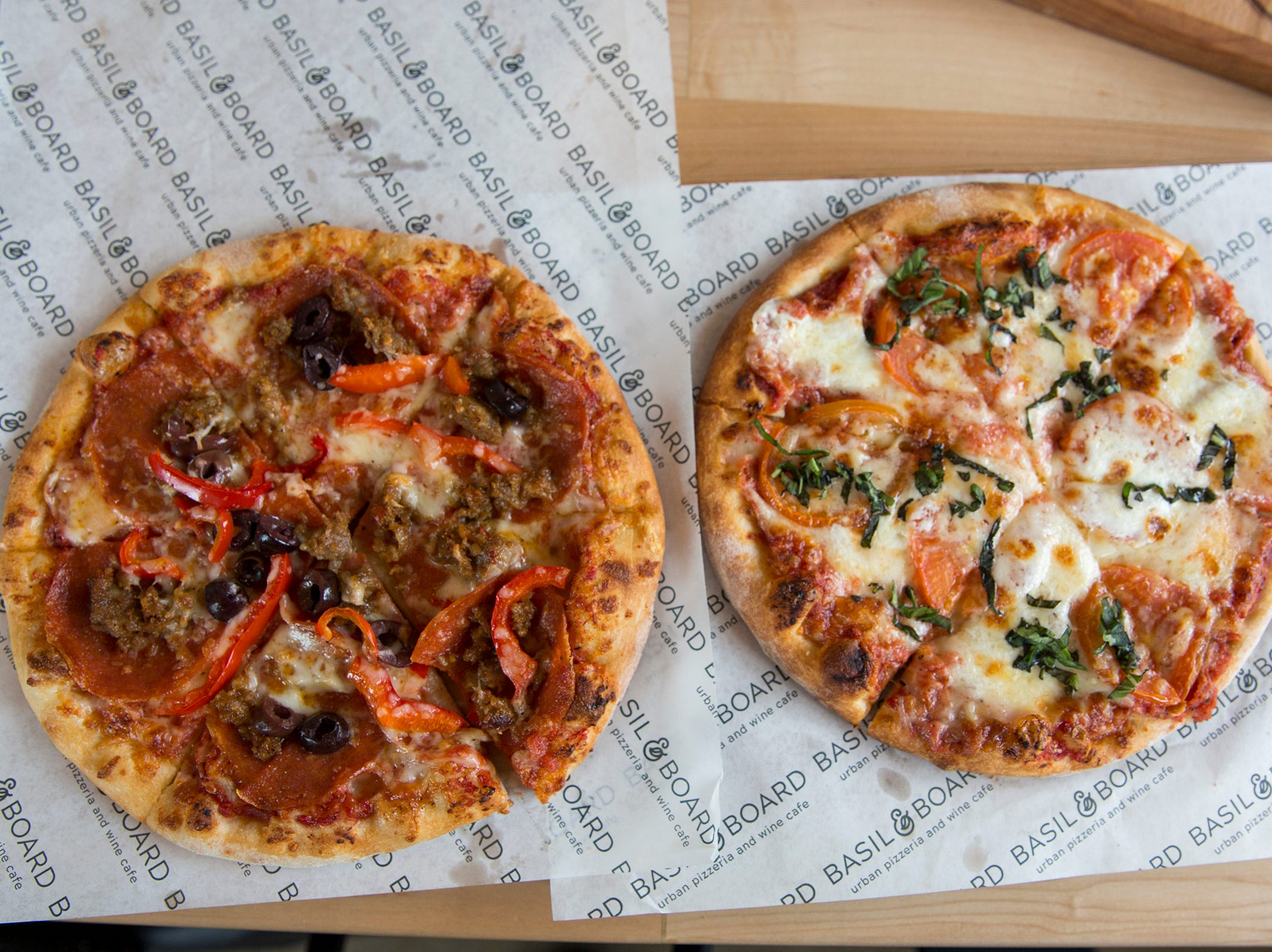 Two individual sized 8 inch pizzas from the lunch menu at Basil & Board are pictured in Salem on Tuesday, Feb. 26, 2019.