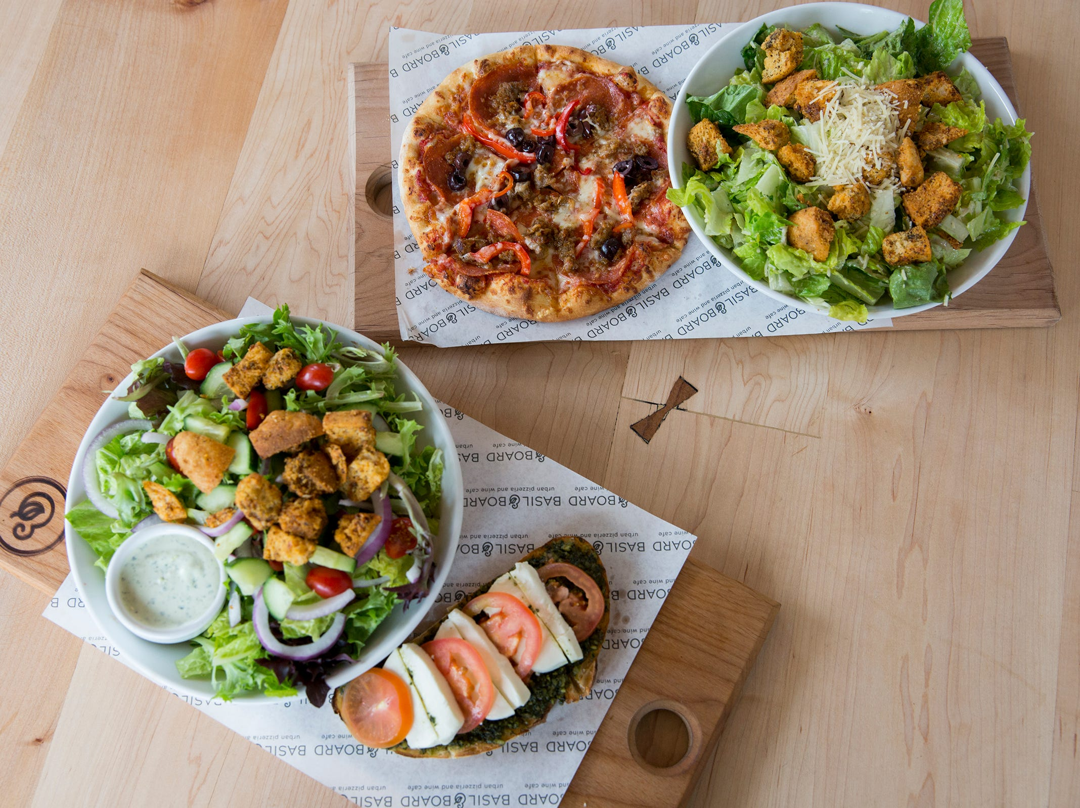 An individual pizza and bruschetta are paired with a salad on the lunch menu combos at Basil & Board in Salem on Tuesday, Feb. 26, 2019.