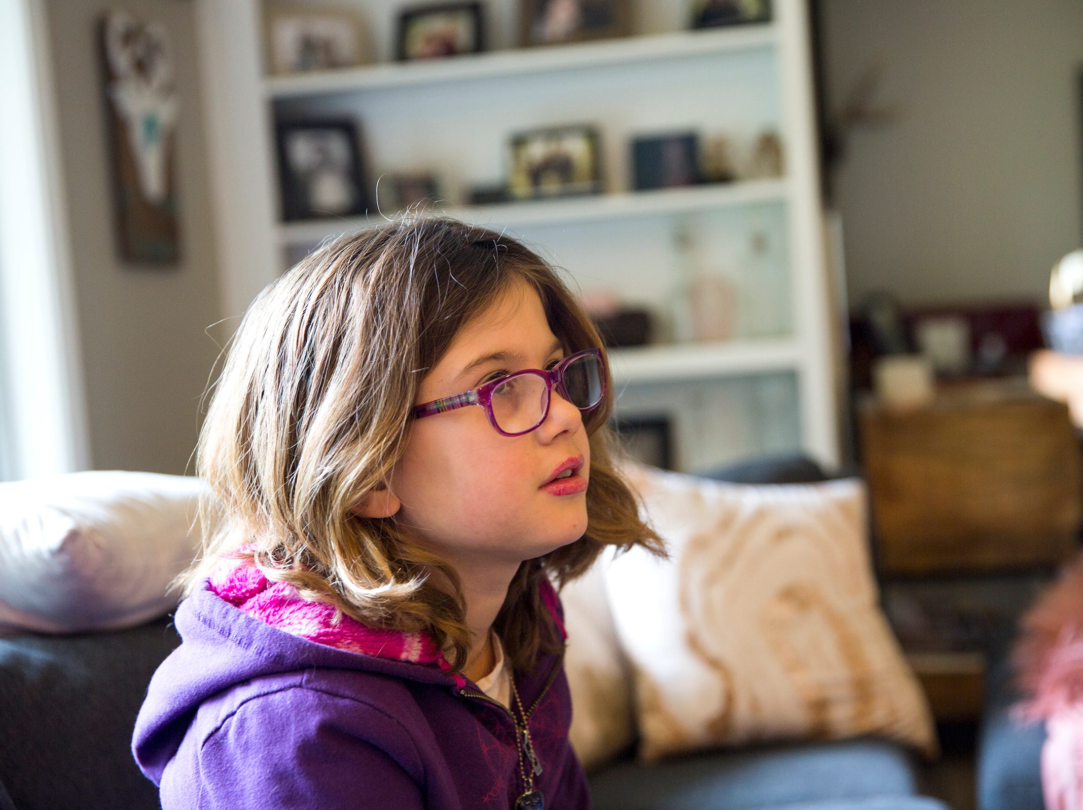 Haley Pollman, 9, is interviewed at her home in Salem on Saturday, Feb. 23, 2019. Haley has Batten disease, a rare disorder of the nervous system.