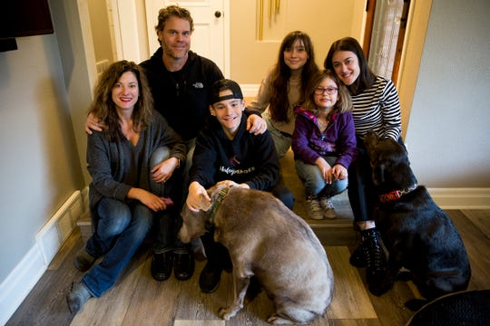 Melissa, Haley, Dean, Cole, Maddie, Audrey and their dogs Gary and Lucy at their home in Salem on Saturday, Feb. 23, 2019.