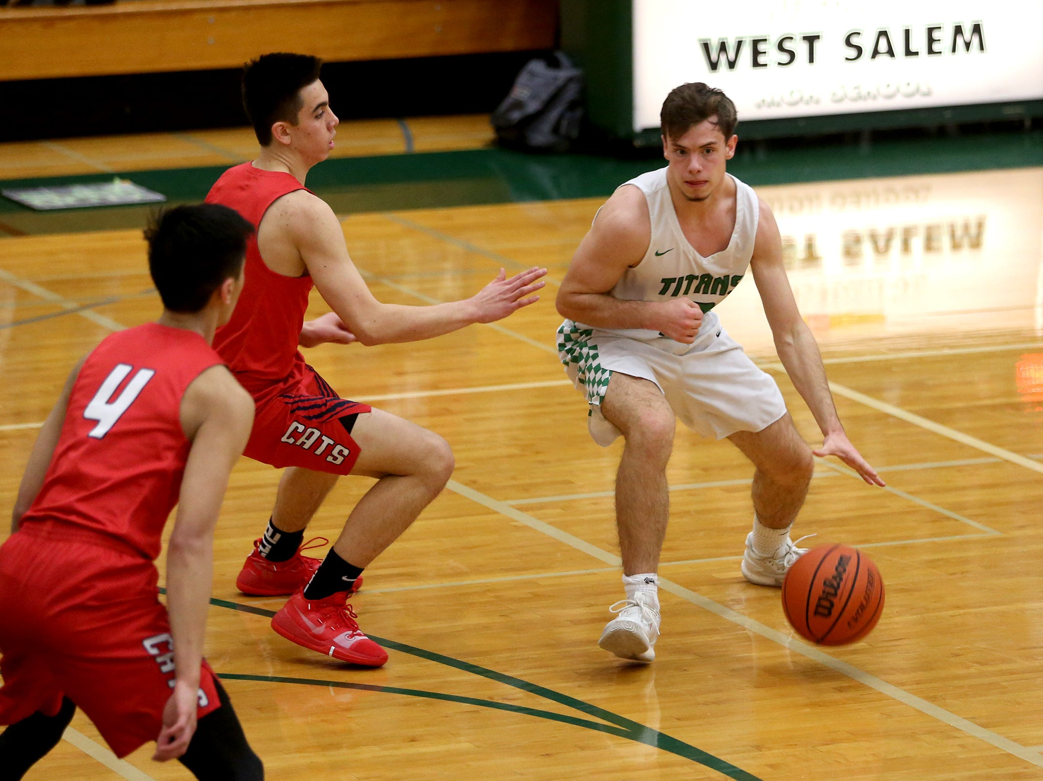West Salem's Kieran Pruett (12) looks for an opening during the West Salem vs. Westview 6A Boys Basketball State Championships first round at West Salem High School in Salem on Tuesday, Feb. 26, 2019.