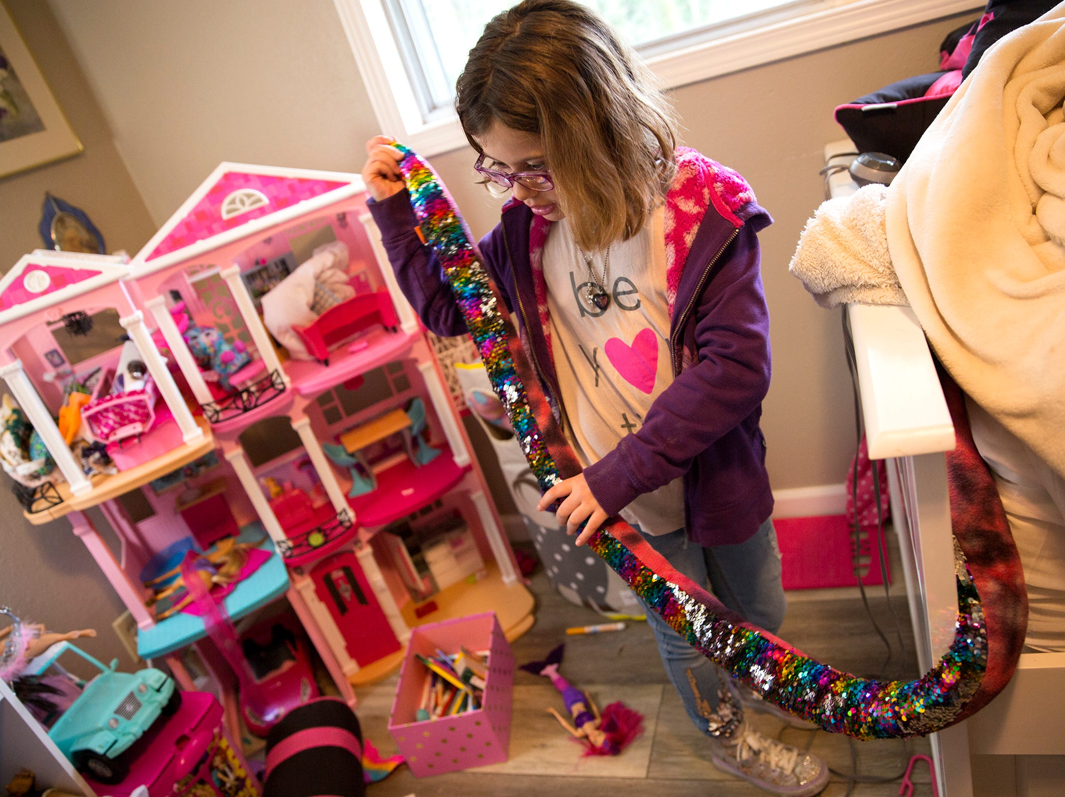 Haley Pollman, a 9-year-old with a rare nervous system disorder, gives a tour of her room at her home in Salem on Saturday, Feb. 23, 2019.