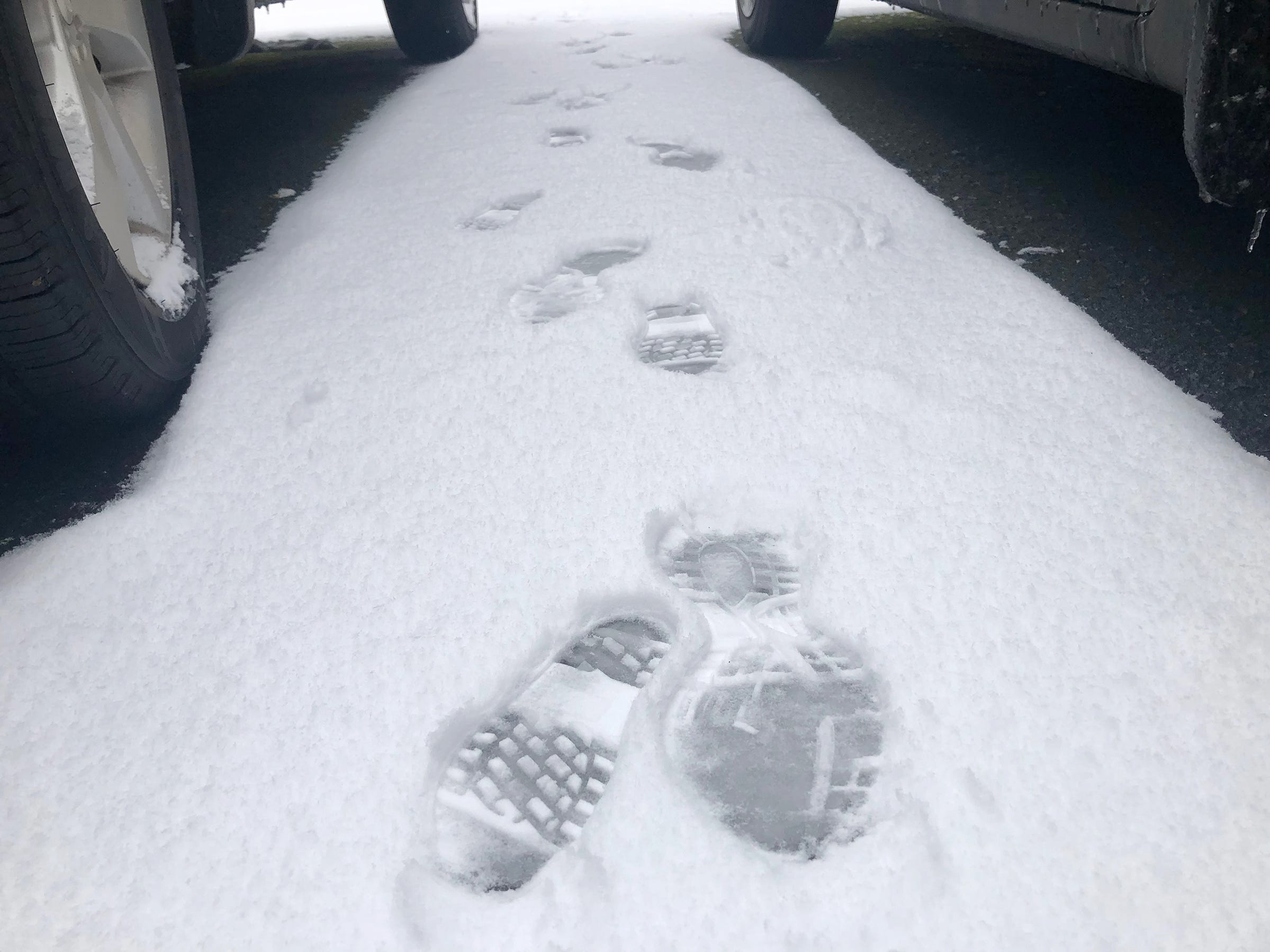 Footprints in the snow between cars in Salem Wednesday February 27, 2019. For a second day this week Salem residents woke up to a blanket of snow.