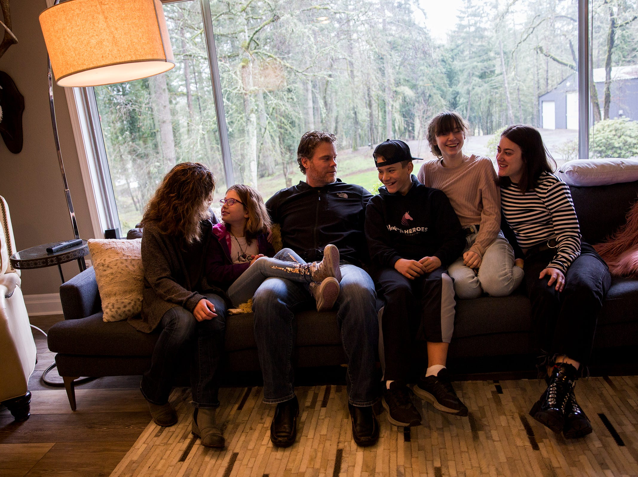 (From left to right) Melissa, Haley, Dean, Cole, Maddie and Audrey at their home in Salem on Saturday, Feb. 23, 2019. The family's foundation, Haley's Heroes, has raised $900,000 so far to fight Batten disease.