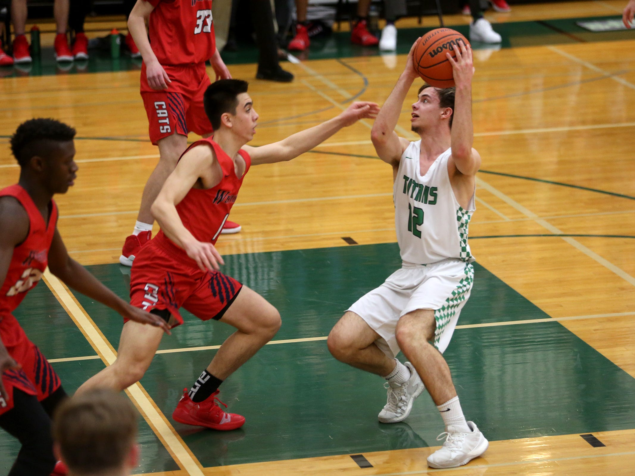 West Salem's Kieran Pruett (12) protects the ball during the West Salem vs. Westview 6A Boys Basketball State Championships first round at West Salem High School in Salem on Tuesday, Feb. 26, 2019.