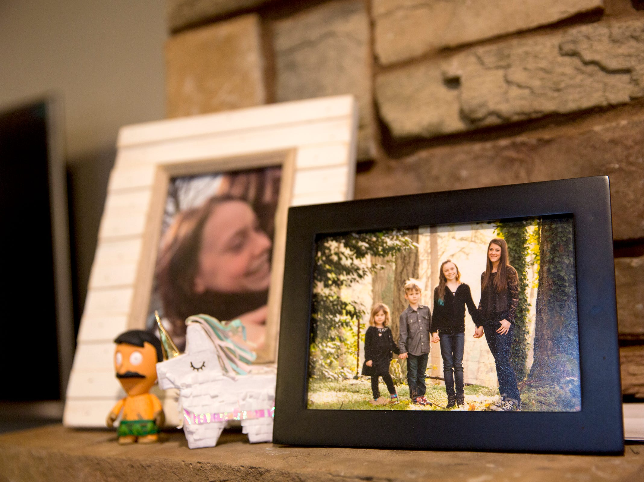 A framed photo of Haley Pollman, 9, and her siblings at their home in Salem on Saturday, Feb. 23, 2019.