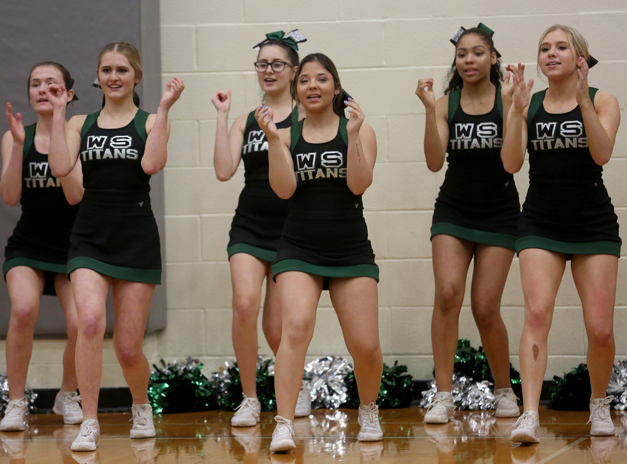 West Salem cheerleaders cheer on their team during the West Salem vs. Westview 6A Boys Basketball State Championships first round at West Salem High School in Salem on Tuesday, Feb. 26, 2019.
