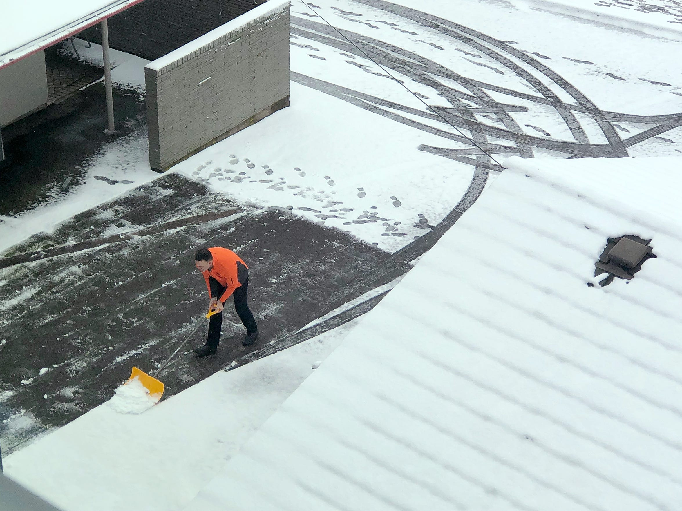 A worker shovels snow from a parking lot along Commercial Street SE in Salem Wednesday February 27, 2019. For a second day this week Salem residents woke up to a blanket of snow.