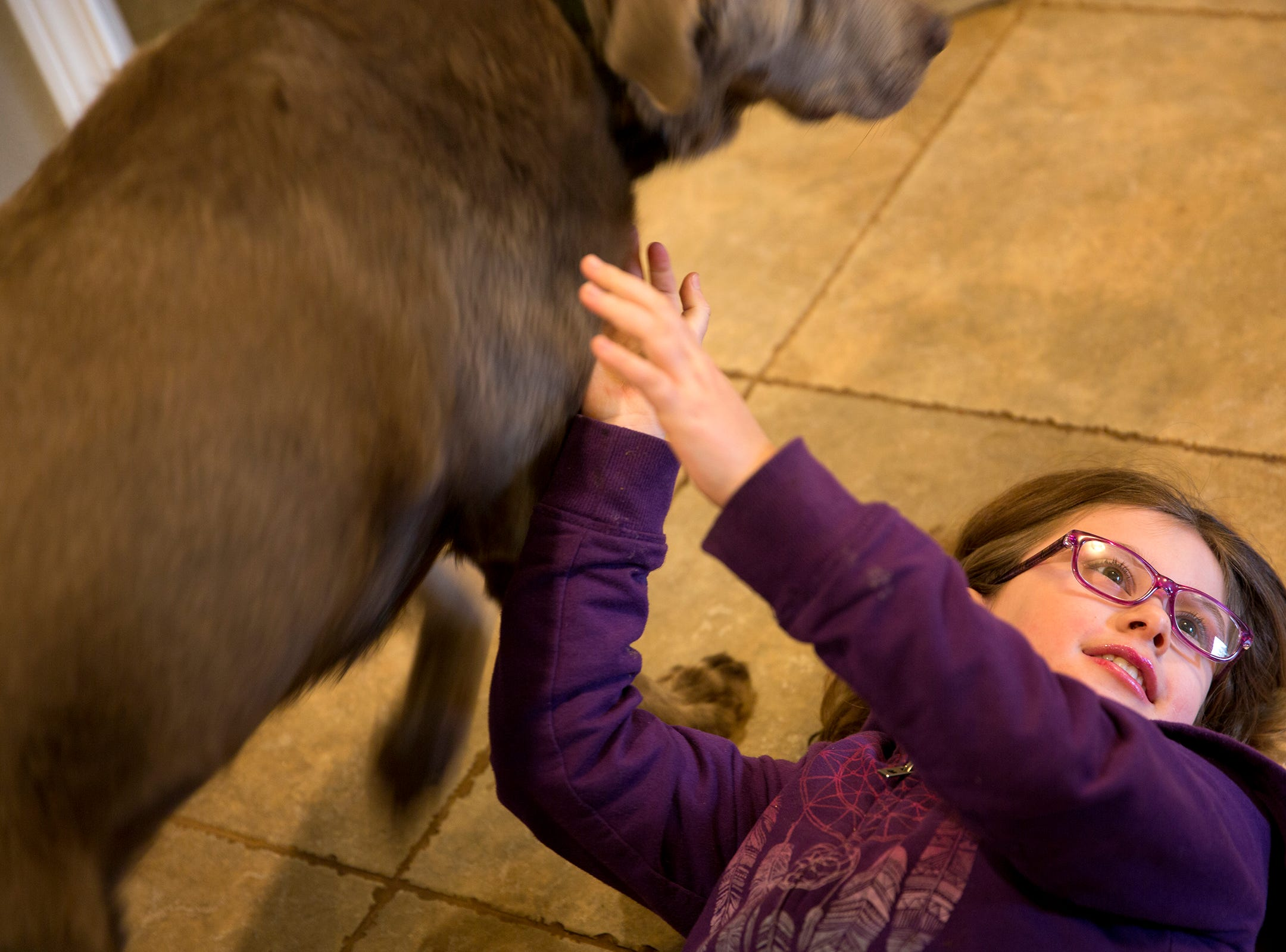 Haley Pollman, 9, plays with her dog Gary at her home in Salem on Saturday, Feb. 23, 2019.