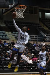 Wicomico High School's Jayson Handy with the layup against Easton High School during the Bayside Conference Championship at the Wicomico Youth & Civic Center.