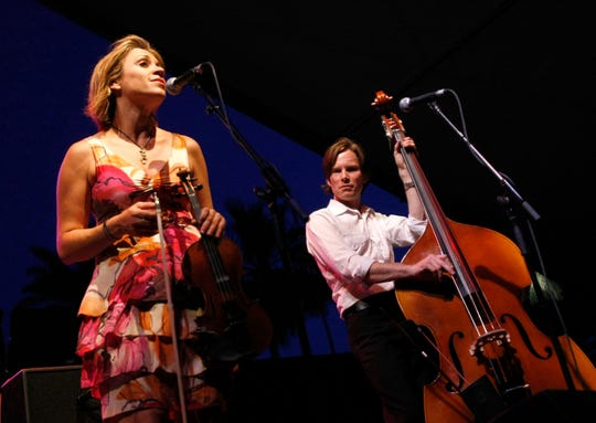 Musicians Elana James (L) and Bill Horton of the Hot Club of Cowtown.
