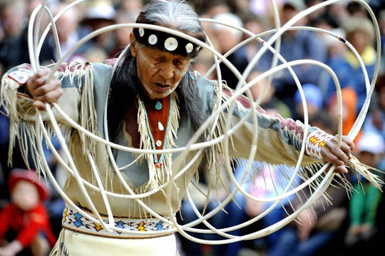 Dine Indian Jones Benally from Arizona, US, performs a hoop-dance during a Pow Wow at the Karl-May festival in Radebeul, eastern Germany.