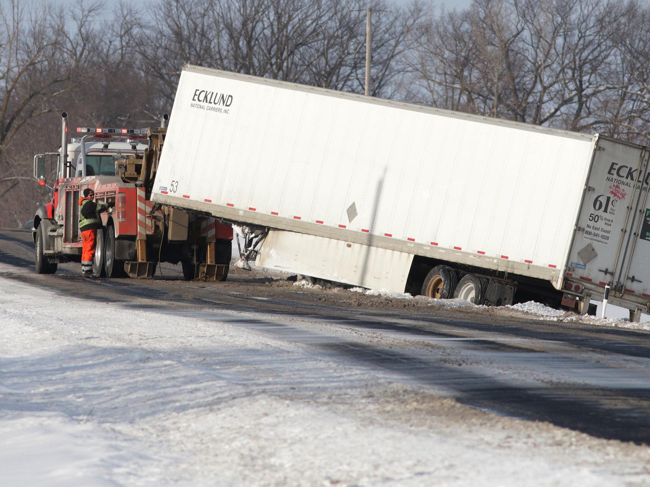 A semi trailer gets pulled out of a ditch on county Road TT near county Road C, Wednesday, February 27, 2019 near Sheboygan Falls, Wis.