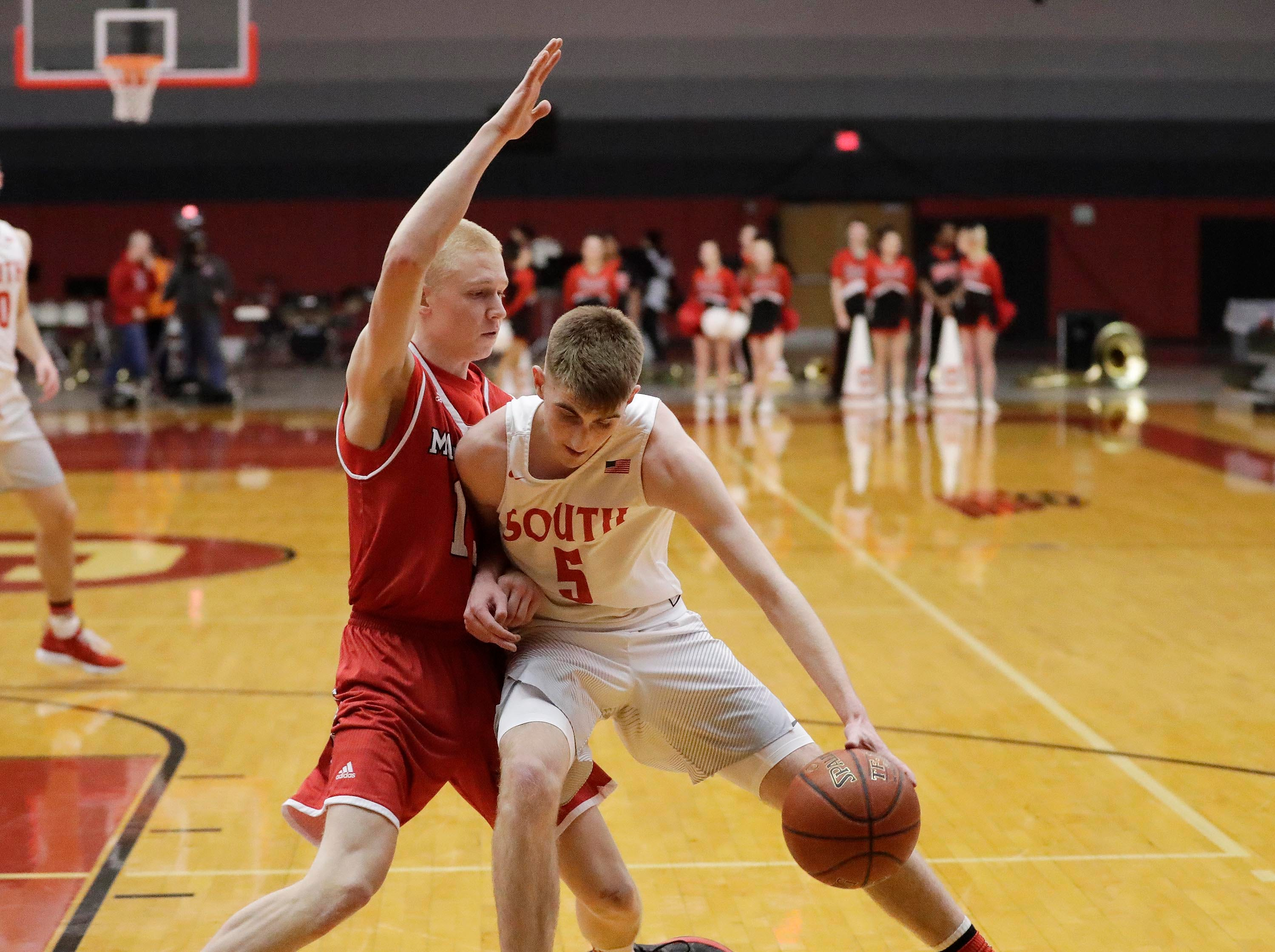 Sheboygan South's Jake Marver (5) driibbles the ball around Manitowoc Lincoln's Sam Jacobson (left), Tuesday, February 26, 2019, in Sheboygan, Wis.