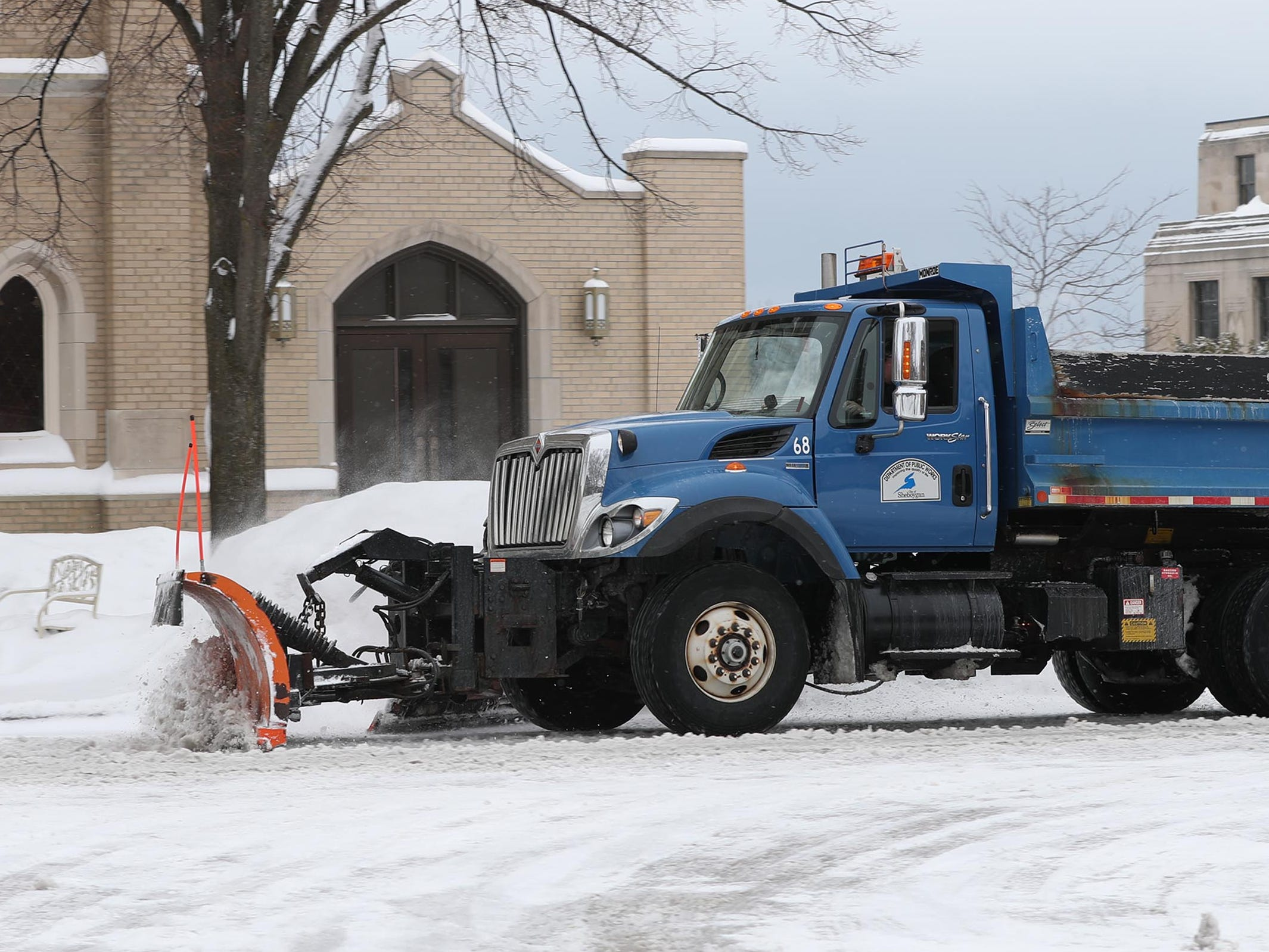 A City of Sheboygan snow plow clears the way on North 6th Street near New York Avenue, Wednesday, February 27, 2019, in Sheboygan, Wis.