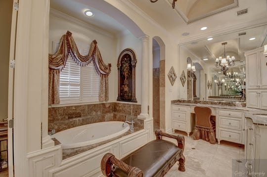 Relax in luxury in the spa-like master bath.