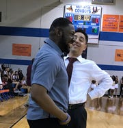 Southwood coach Eddie Hamilton and Natchitoches Central coach Micah Coleman share a laugh Tuesday night before their 2019 LHSAA Class 5A state playoff game.