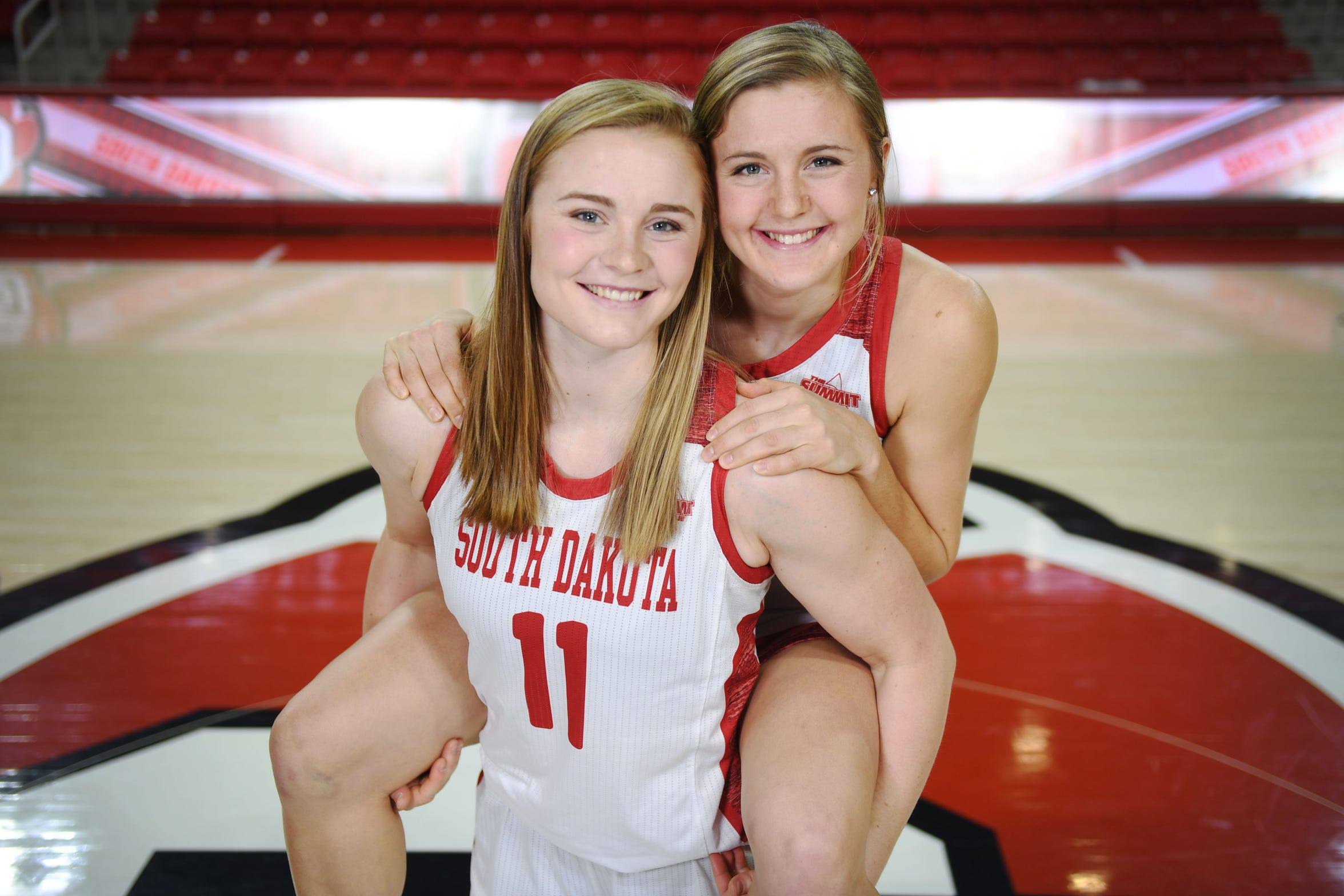Monica Arens (11) and Allison Arens (10) Tuesday, Feb. 27, at Sanford Coyote Sports Center in Vermillion.