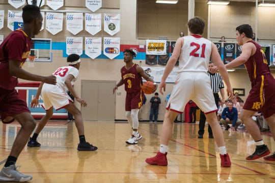 Roosevelt's Tyler Feldkamp (3) dribbles the ball during a game against Lincoln, Tuesday, Feb. 26, 2019 in Sioux Falls, S.D.