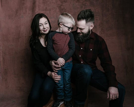 Kathryn, 5-year-old Parker and Tyler Atchley recently shared their story for Springfield photographer Randy Bacon's 7 Billion Ones project. Parker, a kindergartner at McBride Elementary has a rare disorder called KIF1A Associated Neurological Disorder.
