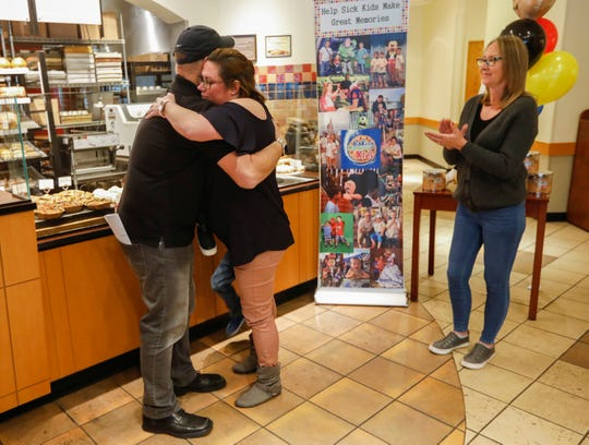 Andrea Juergens hugs Frank Squeo, founder of Baking Memories 4 Kids, after hearing she and her family will be going on a trip to Orlando, Fl., to visit Disney's Magic Kingdom, Universal Studios, and Legoland courtesy of Baking Memories 4 Kids and Panera. Juergens son Harrison has Ollier Disease.