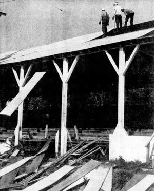 Workmen beginning the razing of the grandstand in Gypsy Hill Park onSept. 28, 1968. The demolition spelled the end of an era in the park.