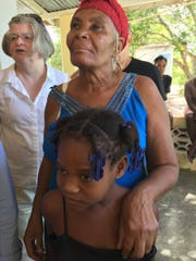 A Woman and granddaughter- Point-a-Raquette, recipients on the food program.