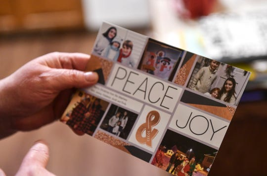 Jean Stephens holds the family Christmas card Tuesday, Feb. 19,  in St. Joseph.