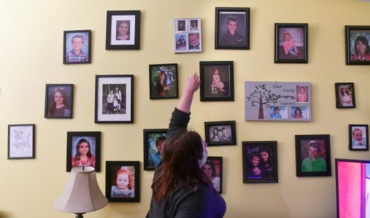 Jean Stephens points out photos of her family Tuesday, Feb. 19, at her home in St. Joseph.