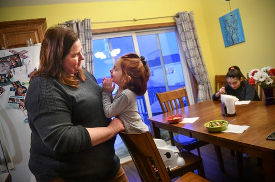 Jean Stephens interacts with 4-year-old Emily Tuesday, Feb. 19, at the family's home in St. Joseph.
