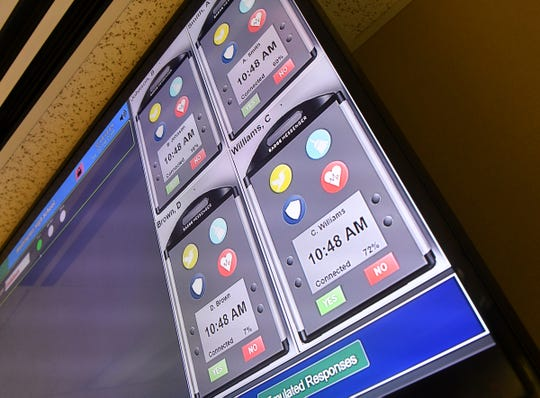 A screen shows how the Badge Messenger system works during a demonstration Tuesday, Feb. 26, at the company in Sauk Rapids.
