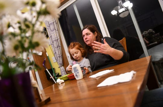 Jean Stephens holds 4-year-old Emily while talking about her experiences as a grandparent and parent Tuesday, Feb. 19, at the family's home in St. Joseph.