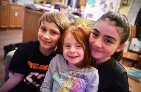 Emily, Kaidance and Scott Stephens pose for a portrait Tuesday, Feb. 19, at their home in St. Joseph.